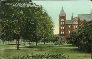 Grounds and Office Building, Mimico Asylum in 1910. Note the administration building's original tower. Picture by Valentine & Sons' Publishing Co. Ltd. Courtesy of Toronto Public Library, Baldwin Collection.