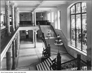 Old City Hall lobby circa 1910. Note the grand staircase, dragon-shaped railings and stained glass window. City of Toronto Archives, Fonds 1244, Item 323G.
