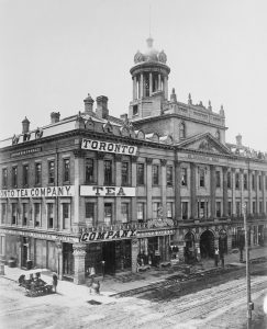 St. Lawrence Hall in 1873. The three arches in the centre originally connected King St to St. Lawrence Market via a shopping arcade. Courtesy of Toronto Public Library.